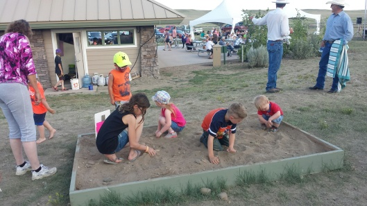 Digging in the treasure sand at Grasslands National Park's Sleep Under the Stars Party